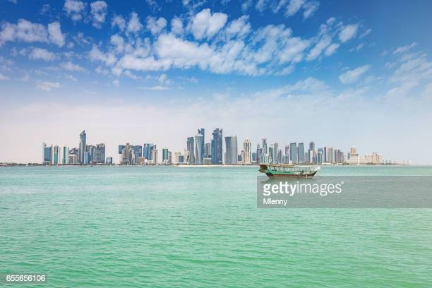 traditional dhow modern doha skyline qatar - doha stock pictures, royalty-free photos & images