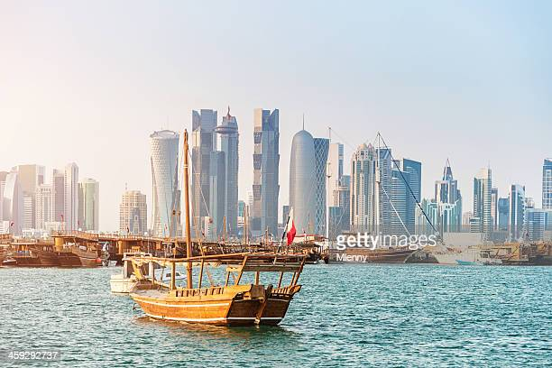 traditional dhows in front of modern doha skyline, qatar - local landmark stock pictures, royalty-free photos & images