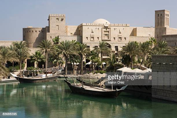 traditional dhows moored in madinat jumeirah - jumeirah stock pictures, royalty-free photos & images