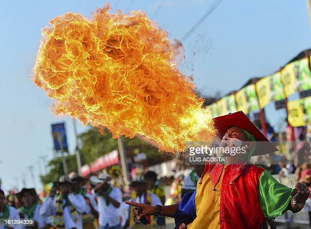 A traditional 'Diablo Arlequin' dancer take part in the second day of carnival parade in Barranquilla Colombia on February 10 2013 Barranquilla's...