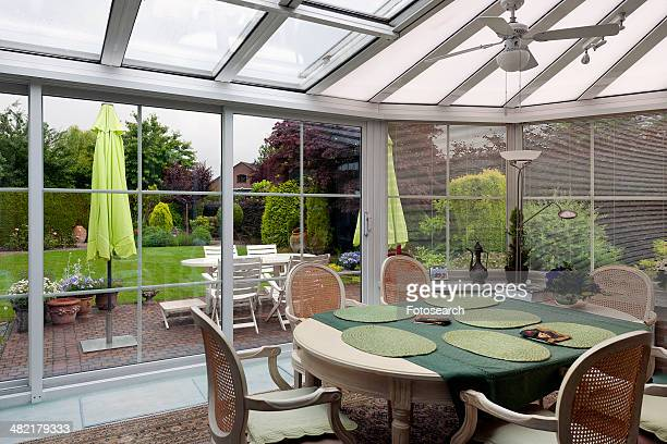 Traditional dining table in sunroom
