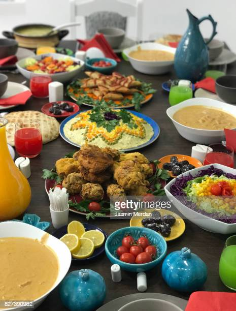 traditional dinner table of mixed middle eastern cultures - iranian culture stock photos and pictures