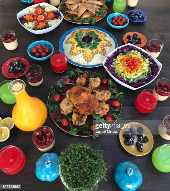 traditional dinner table of mixed middle eastern cultures - iranian culture stock pictures, royalty-free photos & images