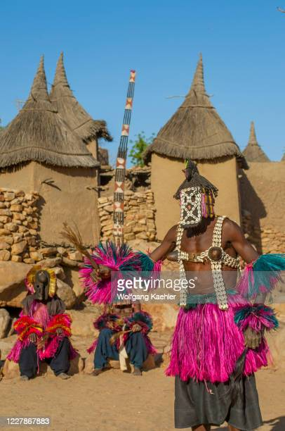 Traditional Dogon dances being performed in a Dogon village at the Bandiagara Escarpment in the Dogon country in Mali, West Africa.