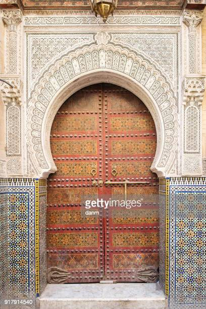 Traditional door in Fez, Morocco. Entrence of a mosque with beautiful ornament.