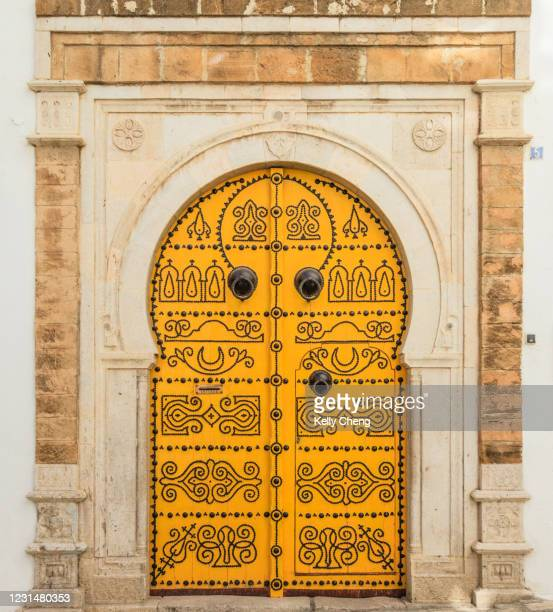 a traditional door in tunisia - islam stock pictures, royalty-free photos & images