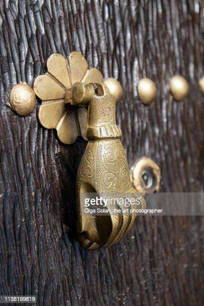 traditional door knocker, distinctive features of moroccan architecture include hamza (five in arabic language) or hand of fatima door-knockers, chefchaouen or chaouen, morocco - hand of fatima stock photos and pictures