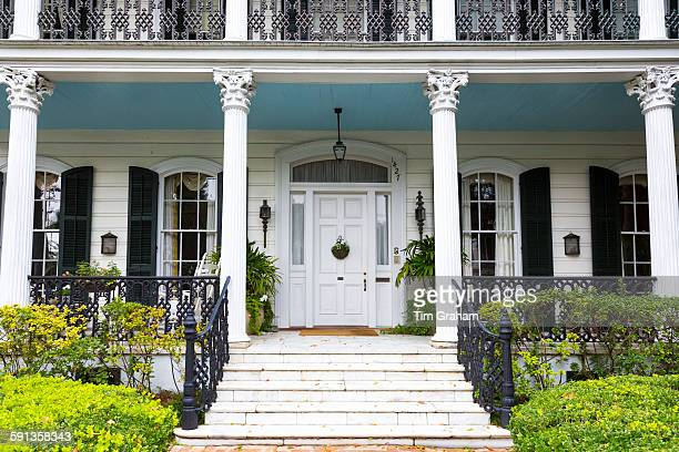 Traditional double gallery grand mansion house with columns and porch in the Garden District of New Orleans Louisiana USA