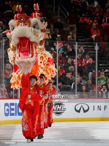 Traditional dragon dance is performed during the second intermission of the game between the Montreal Canadiens and New Jersey Devils as part of the...