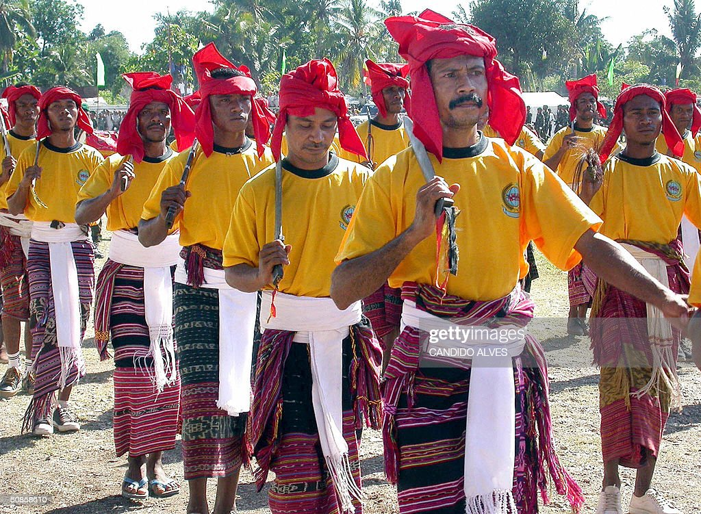 Traditional dressed East Timorese people attend a ceremony to mark the second anniversary of the youngest country in the world, in Dili 20 May 2004. East TImor celebrated the second anniversary of its independence with a display of pomp and pageantry overshadowed by abject poverty in one of the wolrd's newest nations and a bruising oil dispute with Australia.