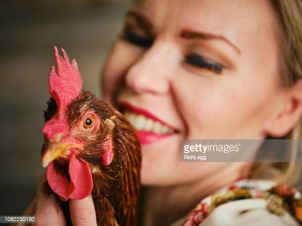 Traditional Dressed Russian Woman with Rooster