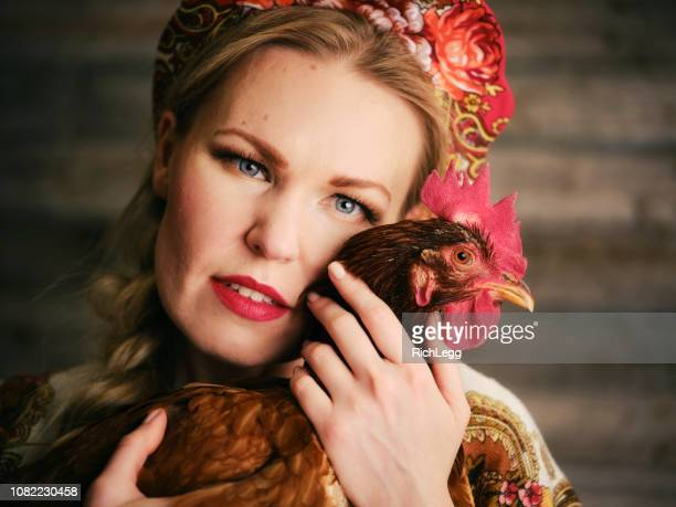 traditional dressed russian woman with rooster - russian culture stock pictures, royalty-free photos & images
