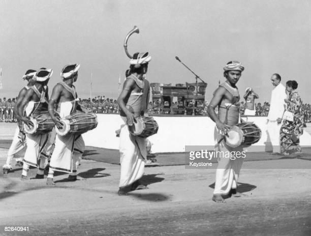 Traditional drummers perform as Sri Lanka's first president Junius Richard Jayewardene arrives for the oathtaking ceremony Columbo Sri Lanka 1978