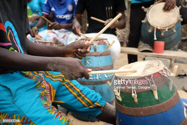traditional drums on the beach in accra, ghana - dietmar temps stock photos and pictures