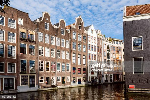 Traditional Dutch houses along the canal in Amsterdam, Netherlands