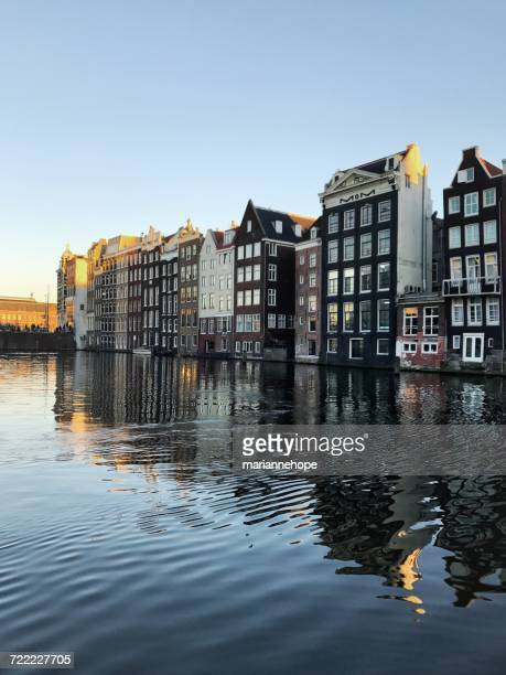Traditional Dutch houses reflected in canal, Amsterdam, Holland