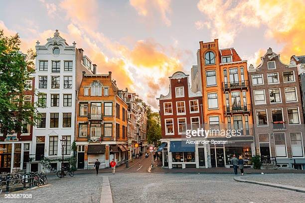 Traditional Dutch old houses in Amsterdam at sunset, Netherlands