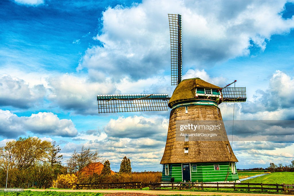 Traditional Dutch Windmill on a Typical Canal in Netherlands : Stock Photo