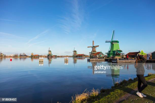 traditional dutch windmills at zaanse schans, amsterdam, netherland - traditional windmill stock photos and pictures