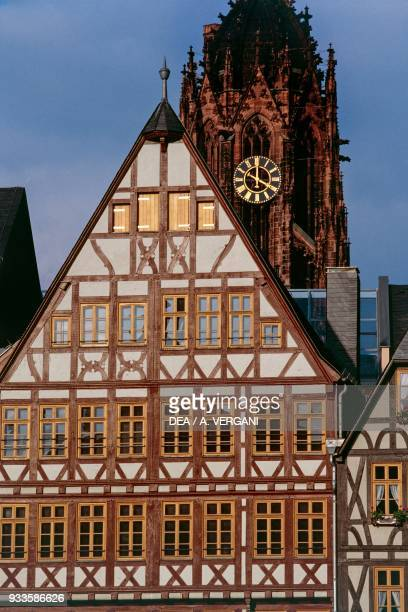 Traditional dwelling in Romerberg square and the bell tower of the cathedral Frankfurt am Main Hessen Germany