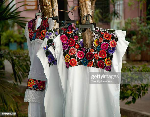traditional embroidered mayan blouses - timothy hearsum stock photos and pictures