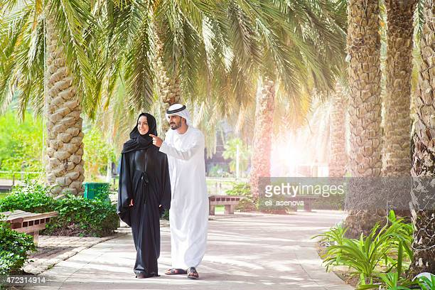 Traditional Emirati young couple enjoying life outdoor