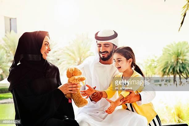 Traditional Emirati young family enjoying weekend.