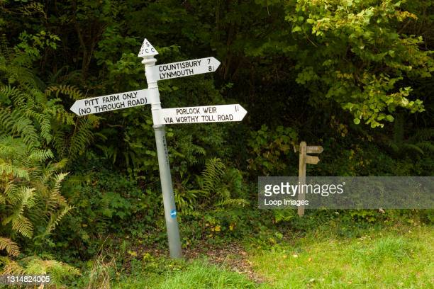 Traditional English cast iron finger rural road sign in Pitt Lane near Porlock Weir in the Exmoor National Park.