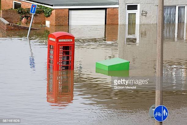 A traditional English phone box is partly submerged on one of the flooded streets of Catcliffe Village This was one of the communities flooded when a...