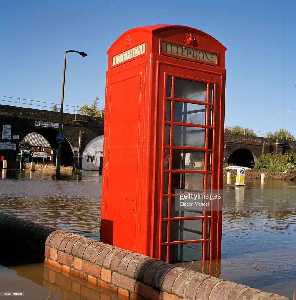 UK - Floods - Telephone box in floodwaters : News Photo