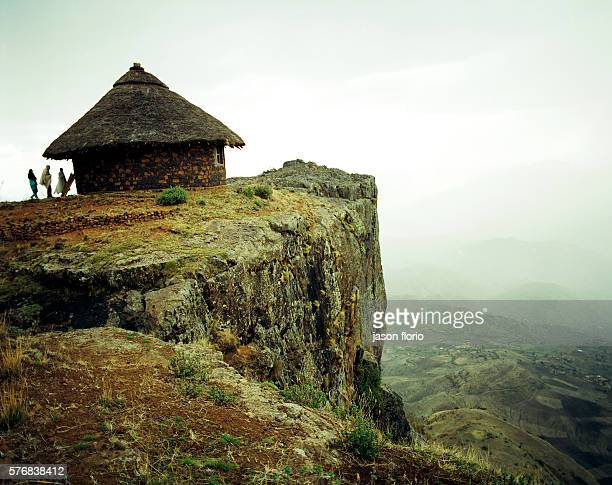 Traditional Ethiopian houses called tukuls perched on the edge of a cliff in the Ethiopian Highlands in the village of Mequat Mariam The houses were...