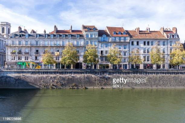 a traditional european town, urban landscape by the french town besancon canal - ブザンソン ストックフォトと画像