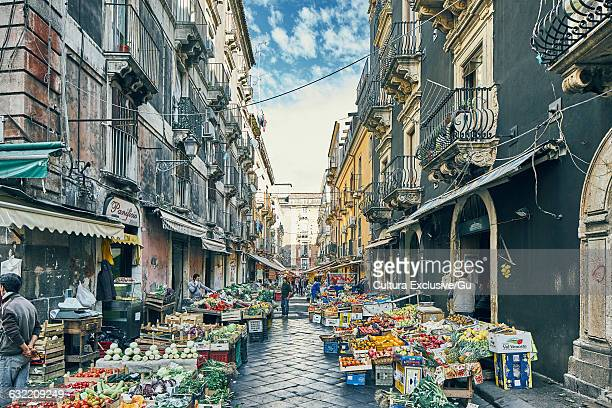 Traditional farmers market on cobbled street, Catania, Sicily, Italy