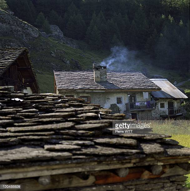 Traditional Farmers Of French Vanoise In Sainte Foy Tarentaise, France In July, 2005 - GAEC du Clou. The Monal is a little mountain hamlet, halfway...