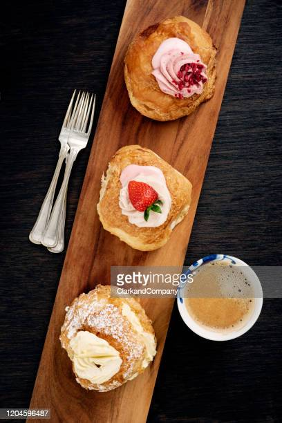 traditional fastelavn cakes or danish cream cakes - danish culture stock pictures, royalty-free photos & images