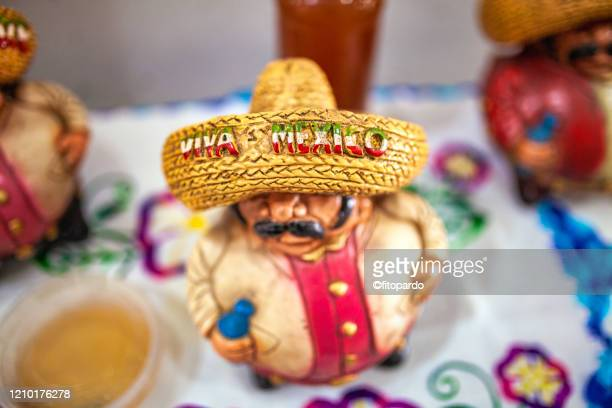 traditional fat figurines from mexico and viva mexico - drunk mexican stock pictures, royalty-free photos & images