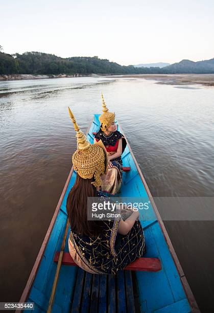 traditional female dancers crossing mekong river, laos - hugh sitton stock pictures, royalty-free photos & images