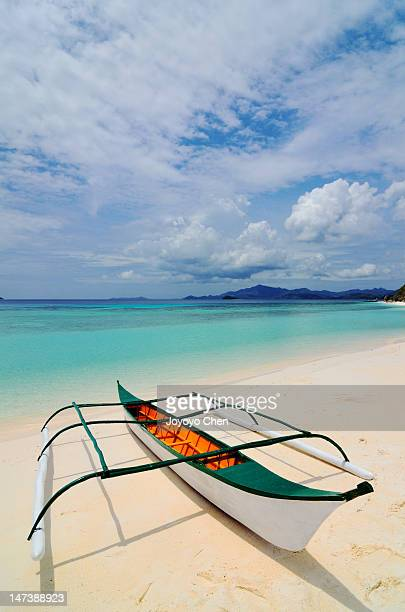 traditional filipino banka outrigger fishing boat - filipino culture stock photos and pictures