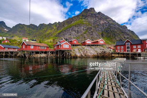 traditional fisher cabins called rorbu in the fishing village å in lifoten islands norway - finn bjurvoll stock pictures, royalty-free photos & images