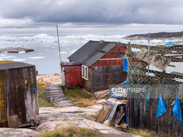 Traditional fishermens hut Town Ilulissat at the shore of Disko Bay in West Greenland center for tourism administration and economy The icefjord...