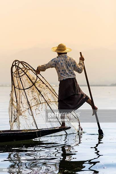 traditional fishing and one leg rowing - merten snijders stock pictures, royalty-free photos & images