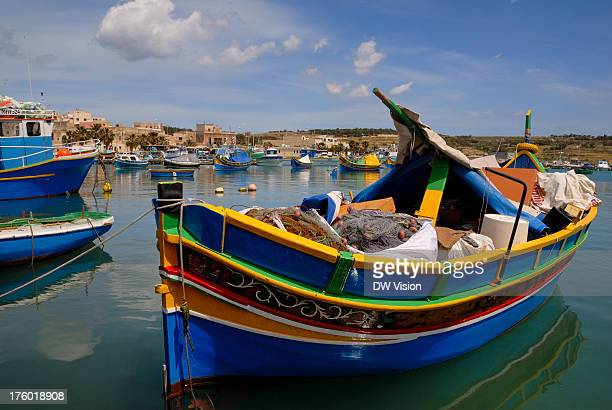 Traditional fishing boat called luzzu ready to take out into the Mediterranean. The luzzu are traditional Maltese boats which are often painted in...