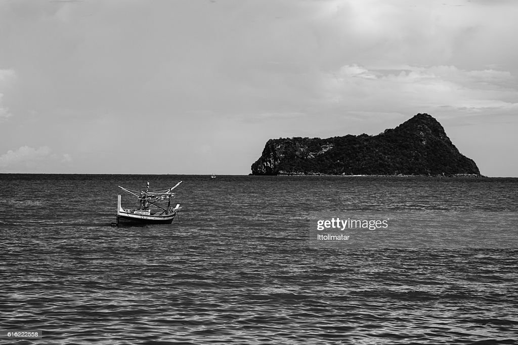 traditional fishing boat laying alone on the sea : Stock Photo
