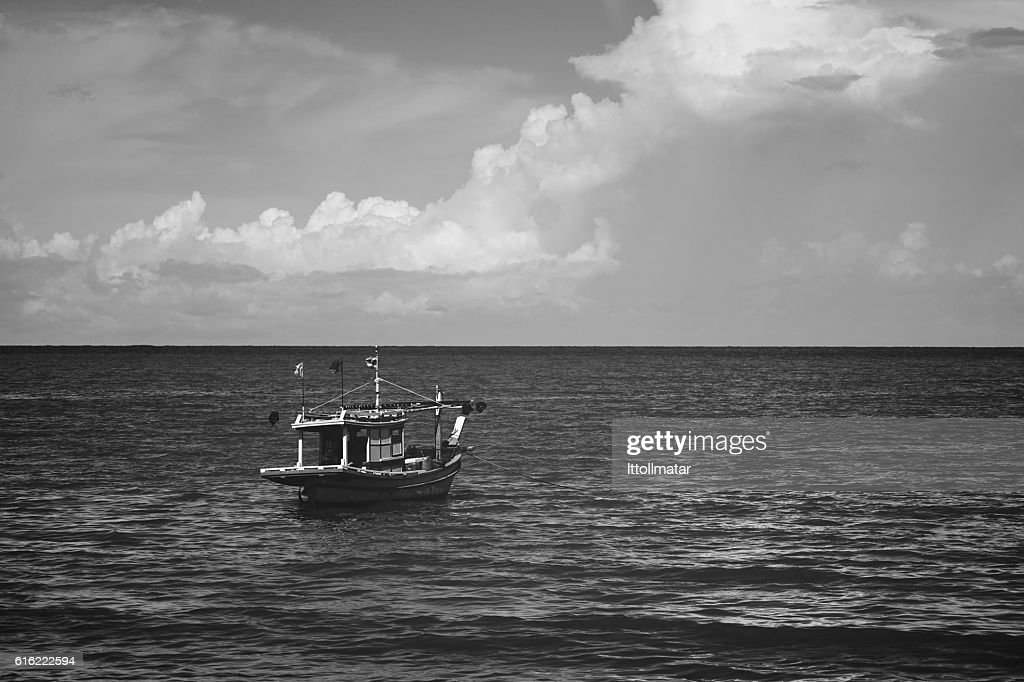 traditional fishing boat laying alone on the sea : Stockfoto