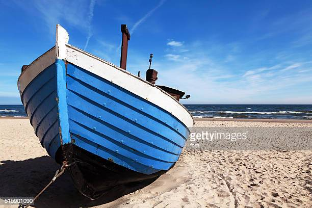traditional fishing boat on the beach of usedom, germany - low tide stock pictures, royalty-free photos & images