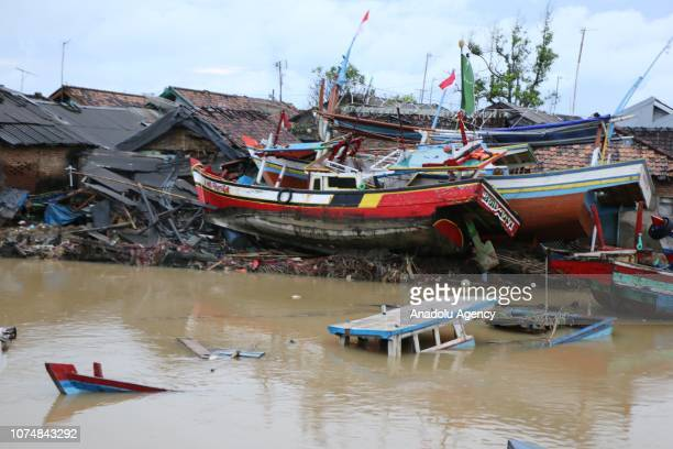 Traditional fishing boats are seen damaged after being hit by a tsunami in Banten Indonesia on December 26 2018 Fishery industry was damaged by the...