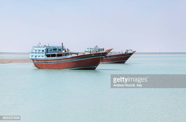 traditional fishing boats in the sea, qeshm island, iran - iranian culture stock pictures, royalty-free photos & images