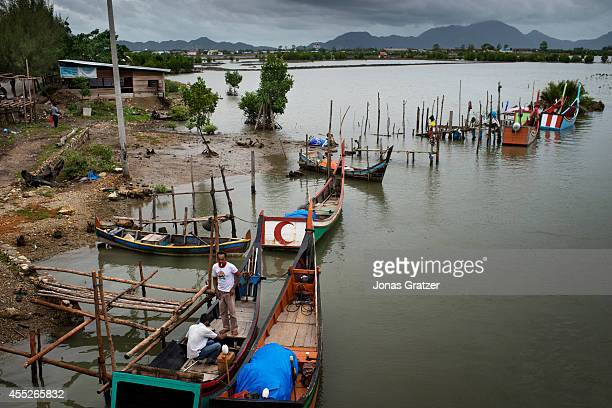 Traditional fishing boats lined up on the Banda Aceh coastline The tsunami of December 2004 was as deadly as the atomic bombs that were dropped on...