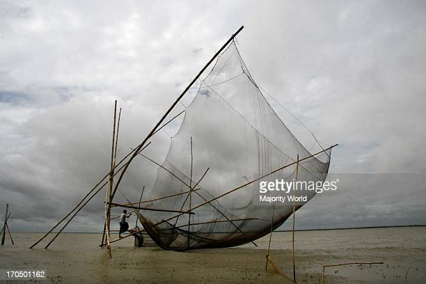 A traditional fishing net on the Jamuna river Aricha ghat in Dhaka Bangladesh July 10 2009