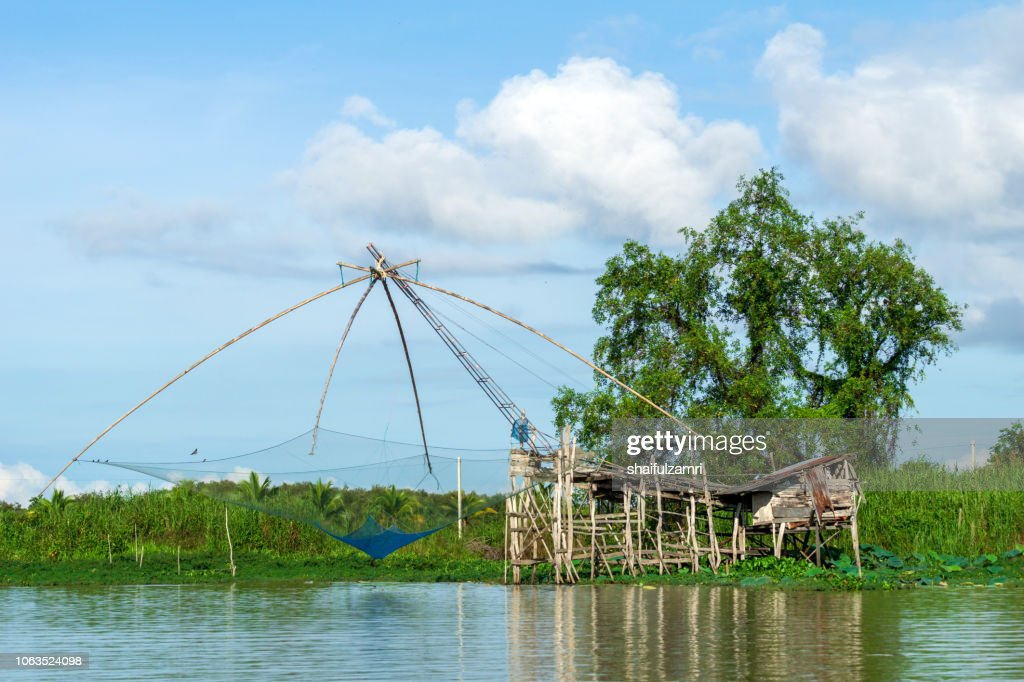 Traditional fishing nets made from bamboo and wood over sunrise at lake Thale Noi, Phatthalung, Thailand. : Stock Photo
